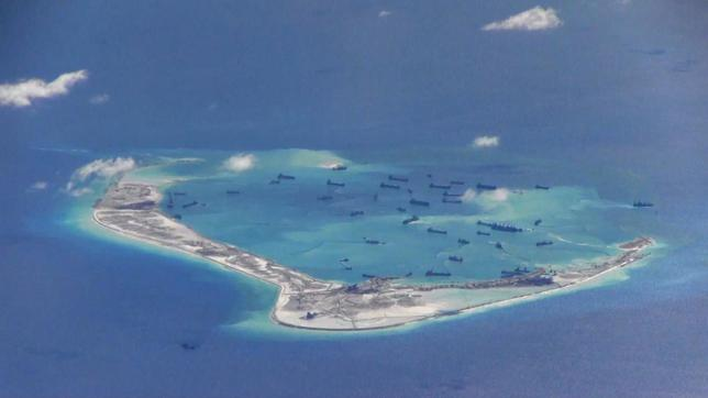Chinese dredging vessels are purportedly seen in the waters around Mischief Reef in the disputed Spratly Islands in this still image from video taken by a P-8A Poseidon surveillance aircraft provided by the United States Navy May 21, 2015. REUTERS/U.S. Navy/Handout via Reuters/Files