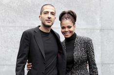 U.S. singer Janet Jackson (R) and her then boyfriend Wissam Al Mana pose for photographers as they arrive to attend the Giorgio Armani Autumn/Winter 2013 collection at Milan Fashion Week, in this file picture taken February 25, 2013.  REUTERS/Alessandro Garofalo/Files