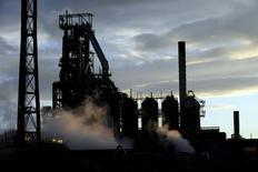 One of the blast furnaces of the Tata Steel plant is seen at sunset in Port Talbot, South Wales in this May 31, 2013 file photo. REUTERS/Rebecca Naden/Files