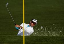 Apr 8, 2016; Augusta, GA, USA; Bubba Watson hits out of a bunker on the 2nd hole during the second round of the 2016 The Masters golf tournament at Augusta National Golf Club. Mandatory Credit: Rob Schumacher-USA TODAY Sports