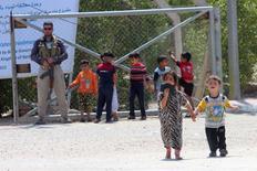Вынужденные покинуть дома из-за войны иракские дети в лагере беженцев в Басре 5 апреля 2016 года. США и ООН решают, что делать с освобождаемым Ираком REUTERS/Essam Al-Sudani