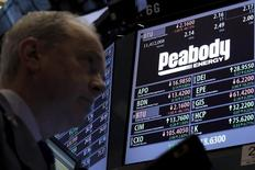 Traders work at the post where Peabody Energy is traded on the floor of the New York Stock Exchange (NYSE) March 16, 2016. REUTERS/Brendan McDermid
