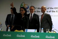 Nawal El Moutawakel (2nd L), chairman of the International Olympic Committee (IOC) Coordination Commission, gestures, accompanied by Rio 2016 Olympic Games Organising Committee President Carlos Arthur Nuzman (2nd R) and Rio 2016 Committee Chief Executive Officer Sidney Levy (R), after a news conference during the IOC Coordination Commission's 10th visit to Rio de Janeiro, Brazil, April 13, 2016. REUTERS/Pilar Olivares