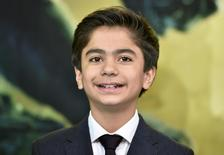 """Actor Neel Sethi poses for photographers as he arrives at the British premiere of the film """"The Jungle Book"""", in London, Britain April 13, 2016. REUTERS/Hannah McKay"""