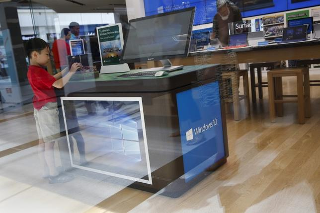 A child stands at a computer display stand for the Windows 10 operating system at the Microsoft store at Roosevelt Field in Garden City, New York July 29, 2015. REUTERS/Shannon Stapleton
