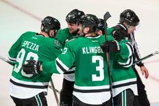 Apr 14, 2016; Dallas, TX, USA; Dallas Stars right wing Patrick Eaves (18) and defenseman John Klingberg (3) and center Jason Spezza (90) and left wing Jamie Benn (14)  celebrate Eaves goal against Minnesota Wild goalie Devan Dubnyk (not pictured) during the third period in game one of the first round of the 2016 Stanley Cup Playoffs at American Airlines Center. The Stars shut out the Wild 4-0. Jerome Miron-USA TODAY Sports