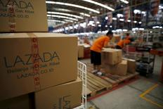 Employees at online retailer Lazada fill orders at the company's warehouse in Jakarta, Indonesia April 15, 2016. REUTERS/Darren Whiteside