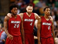 Apr 13, 2016; Boston, MA, USA; Miami Heat forward Justise Winslow (20), forward Josh McRoberts (4) and guard Josh Richardson (0) walk off the court during the first half of a game against the Boston Celtics at TD Garden. Mandatory Credit: Mark L. Baer-USA TODAY Sports