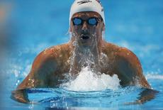 Britain's Michael Jamieson swims in the men's 200m breaststroke heats during the World Swimming Championships at the Sant Jordi arena in Barcelona August 1, 2013.   REUTERS/Albert Gea