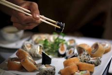 A woman uses chopsticks to eat sushi at a restaurant in La Serena, Chile, June 18, 2015. REUTERS/Marcos Brindicci