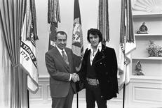 President Nixon shakes hands with Elvis Presley in the Oval Office in Washington, DC in December 1970 after the little-known meeting. Oliver F. Atkins/White House/Nixon Library/Handout via Reuters