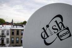 A Dish Network logo is seen on a satellite dish on a Brooklyn apartment building roof in New York June 4, 2015. REUTERS/Brendan McDermid/Files