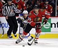 Apr 19, 2016; Chicago, IL, USA; St. Louis Blues left wing Jaden Schwartz (17) defends Chicago Blackhawks center Andrew Shaw (65) during the first period in game four of the first round of the 2016 Stanley Cup Playoffs at United Center. Mandatory Credit: David Banks-USA TODAY Sports