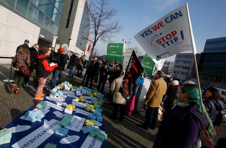 Opponents of the Transatlantic Trade and Investment Partnership (TTIP) protest outside the headquarters of the Christian Democratic Union (CDU) in Berlin, Germany, March 14, 2016.          REUTERS/Fabrizio Bensch