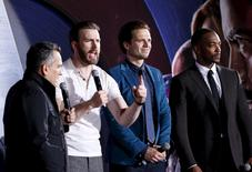 "Director Joe Russo, actors Chris Evans, Sebastian Stan and Anthony Mackie (L-R) speak to fans during a blue carpet event for the movie ""Captain America: Civil War"" in Singapore, April 21, 2016. REUTERS/Edgar Su"