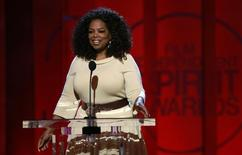 """Entertainer and producer Oprah Winfrey arrives to introduce a clip from her Best Feature nominated film """"Selma"""" at the 2015 Film Independent Spirit Awards in Santa Monica, California February 21, 2015.  REUTERS/Adrees Latif/File Photo"""