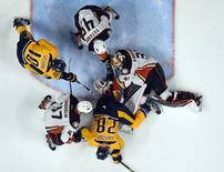Apr 21, 2016; Nashville, TN, USA; Anaheim Ducks goalie Frederik Andersen (31) makes a save with pressure from Nashville Predators center Paul Gaustad (28) and winger Colton Sissons (10) during the third period in game four of the first round of the 2016 Stanley Cup Playoffs at Bridgestone Arena.  The Ducks won 4-1.  Christopher Hanewinckel-USA TODAY Sports