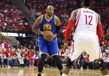 Golden State Warriors center Marreese Speights (5) looks to pass the ball during the first half against the Houston Rockets in game three of the first round of the NBA Playoffs at Toyota Center. The Rockets won 97-96. Mandatory Credit: Troy Taormina-USA TODAY Sports