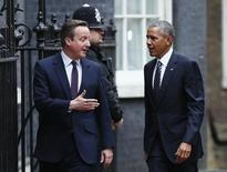 Президент США Барак Обама и премьер Великобритании Дэвид Кэмерон у резиденции британского премьера в Лондоне. 22 апреля 2016 года. Президент США Барак Обама обратился к Великобритании с эмоциональным призывом остаться в составе Европейского союза, сказав, что членство в блоке укрепило позиции страны в мире и сделало ЕС сильнее и более ориентированным на контакты с другими странами. REUTERS/Stefan Wermuth