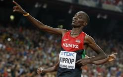 Asbel Kiprop of Kenya reacts after winning the men's 1500 metres final during the 15th IAAF World Championships at the National Stadium in Beijing, China, August 30, 2015.        REUTERS/Phil Noble