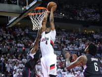Apr 23, 2016; Portland, OR, USA; Portland Trail Blazers forward Maurice Harkless (4) dunks over Los Angeles Clippers guard Jamal Crawford (11) in the second half in game three of the first round of the NBA Playoffs at Moda Center at the Rose Quarter. Mandatory Credit: Jaime Valdez-USA TODAY Sports