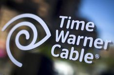 A Time Warner Cable sign and logo are seen on a Time Warner Cable store in the Manhattan borough of New York City, May 26, 2015. REUTERS/Mike Segar -