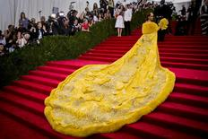 """Singer Rihanna, wearing a dress by the Beijing-based designer Guo Pei, arrives at the Metropolitan Museum of Art Costume Institute Gala 2015 celebrating the opening of """"China: Through the Looking Glass"""" in Manhattan, New York May 4, 2015.  REUTERS/Lucas Jackson/File Photo"""