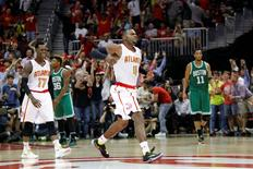 Apr 26, 2016; Atlanta, GA, USA; Atlanta Hawks forward Paul Millsap (4) and guard Dennis Schroder (17) react against the Boston Celtics in the third quarter in game five of the first round of the NBA Playoffs at Philips Arena. Mandatory Credit: Brett Davis-USA TODAY Sports
