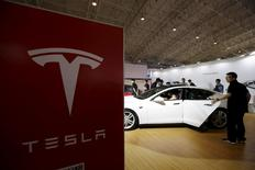 People visit a Tesla Model S car during the Auto China 2016 in Beijing, China, April 25, 2016. REUTERS/Jason Lee