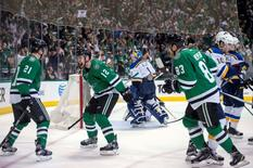 Apr 29, 2016; Dallas, TX, USA; Dallas Stars left wing Antoine Roussel (21) and center Radek Faksa (12) and right wing Ales Hemsky (83) celebrate Roussel's goal against St. Louis Blues goalie Brian Elliott (1) during the second period in game one of the second round of the 2016 Stanley Cup Playoffs at the American Airlines Center. Mandatory Credit: Jerome Miron-USA TODAY Sports