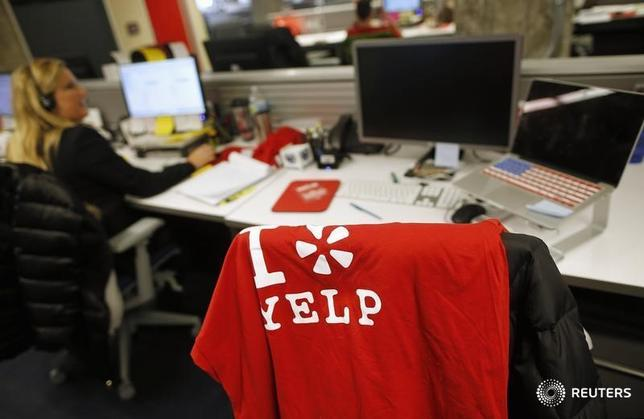 An employee works in the Yelp Inc. offices in Chicago, Illinois, March 5, 2015.REUTERS/Jim Young
