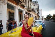 Brazilian top model Gisele Bundchen poses before a fashion show by German designer Karl Lagerfeld as part of his latest inter-seasonal Cruise collection for fashion house Chanel at the Paseo del Prado street in Havana, Cuba, May 3, 2016. REUTERS/Alexandre Meneghini