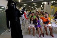 Members of a Star Wars fan club in Thailand, dressed as Kylo Ren, entertains children during Star Wars Day celebration at the Queen Sirikit National Institute of Child Health in Bangkok, Thailand, May 4, 2016. REUTERS/Chaiwat Subprasom