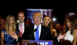 Republican U.S. presidential candidate Donald Trump speaks as he stands surrounded by (L-R) his daughter Ivanka, his son Eric, Eric Trump's wife Lara Yunaska and his wife Melania (R), during a campaign victory party after rival candidate Senator Ted Cruz dropped out of the race for the Republican presidential nomination, at Trump Tower in Manhattan, New York, U.S., May 3, 2016.  REUTERS/Lucas Jackson