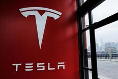 A Tesla logo is painted on a wall inside of a Tesla dealership in New York, U.S., April 29, 2016. REUTERS/Lucas Jackson