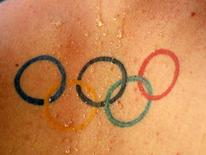 A tattoo of the Olympic rings logo is seen on the back of Hungary's Olympic hopeful Gergo Kis during the Hungarian Swimming Championship in Budapest July 11, 2008.  REUTERS/Laszlo Balogh