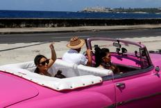 Kim Kardashian waves from the backseat of a vintage car at the seafront Malecon in Havana, Cuba, May 5, 2016. REUTERS/Stringer