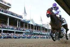 May 7, 2016; Louisville, KY, USA; Mario Gutierrez aboard Nyquist (13) reacts after winning the 142nd running of the Kentucky Derby at Churchill Downs. Mandatory Credit: Brian Spurlock-USA TODAY Sports