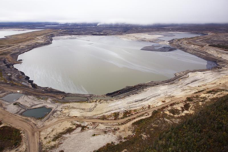 Syncrude says it is shutting down alberta oil sands mines for Pond companies near me