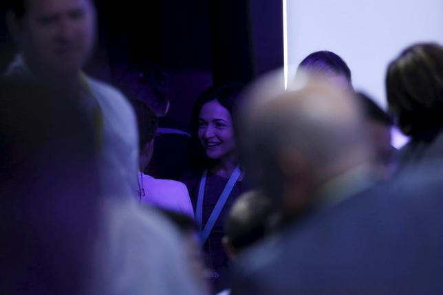 Sheryl Sandberg, chief operating officer at Facebook, is seen amongst the crowd during the Facebook F8 conference in San Francisco, California April 12, 2016. REUTERS/Stephen Lam