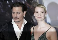 Actors Mia Wasikowska and Johnny Depp arrive at the European Premiere of Alice Through the Looking Glass at a cinema in London, Britain, May 10, 2016. REUTERS/Paul Hackett