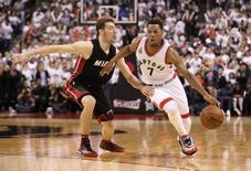 May 11, 2016; Toronto, Ontario, CAN; Toronto Raptors point guard Kyle Lowry (7) drives to the basket past Miami Heat point guard Goran Dragic (7) in game five of the second round of the NBA Playoffs at Air Canada Centre. The Raptors beat the Heat 99-91. Mandatory Credit: Tom Szczerbowski-USA TODAY Sports