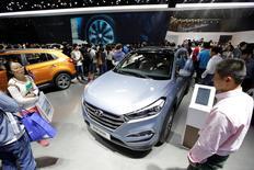 Visitors walk around the new Hyundai Tucson during Auto China 2016 auto show in Beijing, China, May 4, 2016. REUTERS/Jason Lee