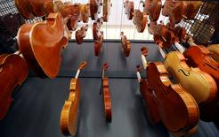 Violins made by students hang to dry at a laboratory of the Antonio Stradivari institute of higher education in Cremona, Italy, April 22, 2016. REUTERS/Stefano Rellandini