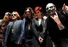 """Ozzy Osbourne (C) and his wife Sharon pose with Geezer Butler (2nd L) of Black Sabbath, Zakk Wylde (L) and Slipknot member Corey Taylor (R) at a news conference to announce the """"Ozzfest Meets Knotfest"""" music festival at the Hollywood Palladium in Los Angeles, U.S., May 12, 2016.   REUTERS/Mario Anzuoni"""
