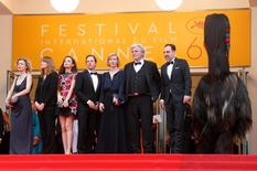 "Cast memberLucy Russell, director Maren Ade, cast members Ingrid Bisu, Trystan Putter, Sandra Huller, Peter Simonischek and Thomas Loibl (L to T) pose on the red carpet as they leave after the screening of the film ""Toni Erdmann"" in competition at the 69th Cannes Film Festival in Cannes, France, May 14, 2016.    REUTERS/Yves Herman"