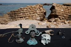 Items, which the Israel Antiquities Authority (IAA) estimate to be around 1600 years old, are displayed after they were recovered from a merchant ship in the ancient harbor of the Caesarea National Park May 16, 2016. REUTERS/ Baz Ratner