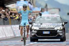 Mikel Landa Meana of Spain celebrates as he crosses the finish line in the 174 km (108 miles) 16th stage of the 98th Giro d'Italia (Tour of Italy) cycling race from Pinzolo to Aprica, Italy, May 26, 2015. REUTERS/LaPresse/Fabio Ferrari