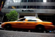 A taxi passes a BlackRock building in New York, United States, June 12, 2009. REUTERS/Eric Thayer/File Photo