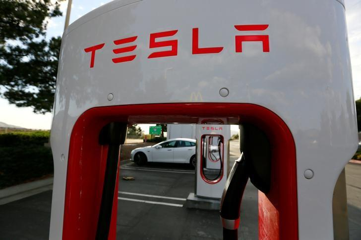 Tesla raises $1 46 billion in stock sale: IFR - Reuters